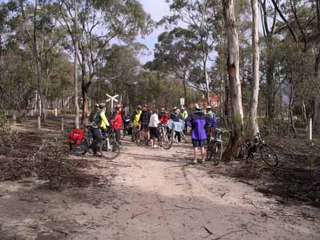 Group of cyclists gathered on the O'Keefe Rail Trail