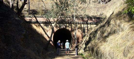 Three people standing at one entrance of the Cheviot tunnel