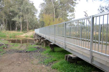 Bridge with old timber pylons and new concrete decking