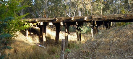 Old timber railway bridge over a culvert