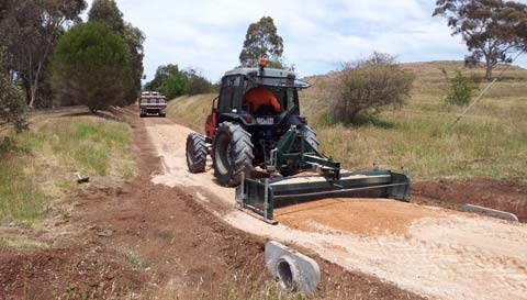 Tractor spreading gravel over new bicycle/walking track