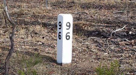 Newly painted number 96 milepost