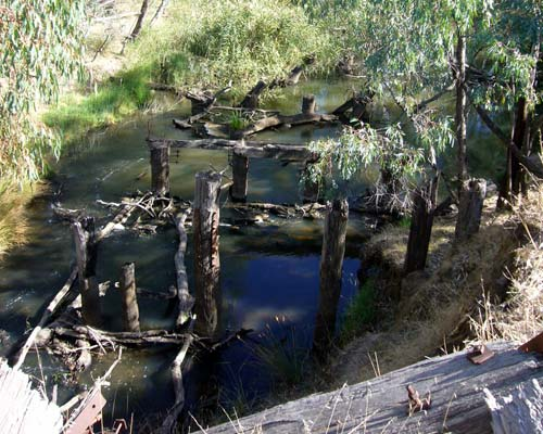 Remnants of bridge pylons in a creek