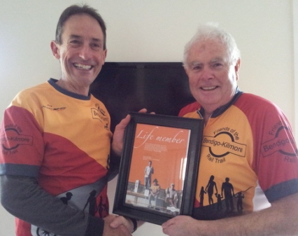 President Garry Long (left) recieves Life Membership from Colin Campbell