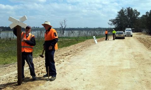 riends members installing replica whistle posts, Lake Eppalock Causeway, Derrinal