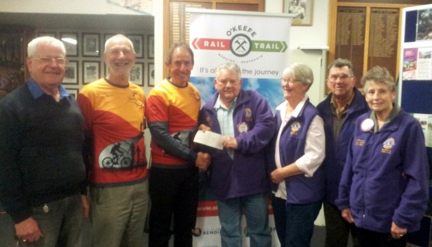 Daryl Dedman Heathcote Lions Club presents a cheque to Friends President Garry Long for two new table-seats for O'Keefe Rail Trail.