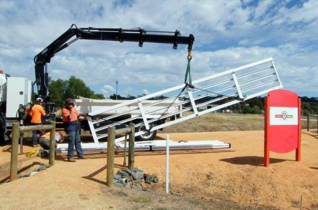 Refurbished railway gates arrive in Heathcote. Photo: Ken Hanson