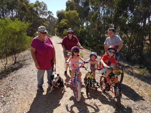 Children learning to ride new bikes on the O'Keefe Rail Trail